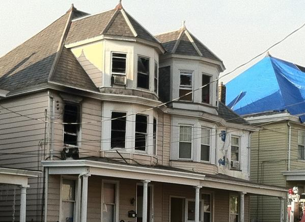 A fire at 724 Spring Garden Street, at left, in Easton early Monday has left three people dead.
