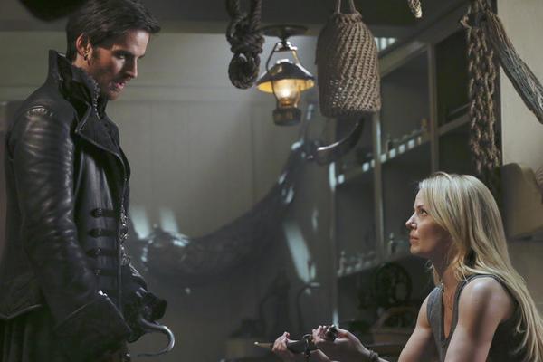 """In """"Heart of the Truest Believer,"""" Captain Hook (Colin O'Donoghue) offers Emma (Jennifer Morrison) a sword."""