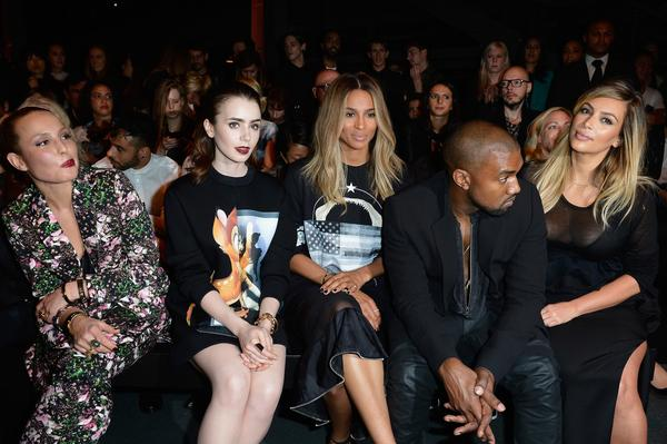 Actresses Noomi Rapace, left, Lily Collins, singer Ciara, Kanye West and Kim Kardashian attend the Givenchy show Sunday during Paris Fashion Week.