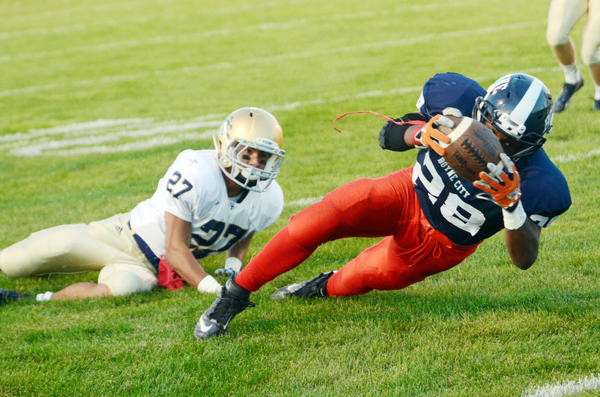 Boyne City running back Malik Smith keeps his knee off the ground as he stretches for his second touchdown in the first half Friday against Traverse City St. Francis. Smith totaled 226 yards in the game with three touchdowns on 24 carries.