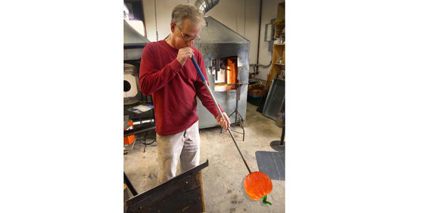 Harry Boyer from Boyer Glassworks in Harbor Springs creates a glass pumpkin.