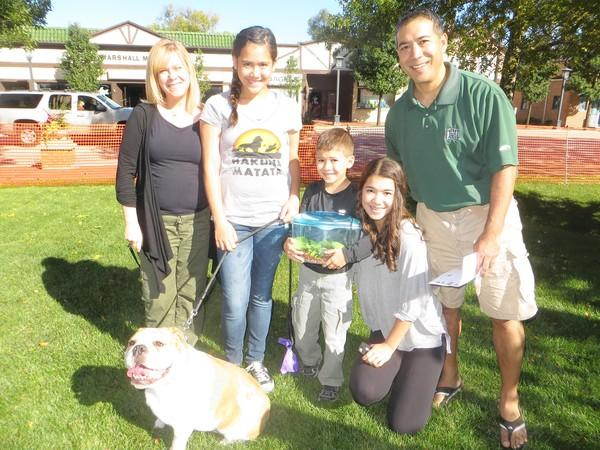 Courtney, Dan, Molly, Caroline, and Inoa Nakahara with their dog, Cannon, and their pet gecko, participated in the pet blessing at the First Presbyterian Church in Deerfield on Sunday.