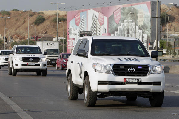 A convoy of a U.N. team of weapons inspectors, who concluded its almost week-long mission in Syria, arrive at Rafik Hariri international airport in Beirut on Monday -- the same day that inspectors from the Organization for the Prohibition of Chemical Weapons were arriving on their way into Syria.