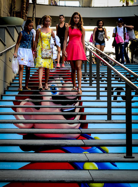 Visitors walk down a set of stairs at the Hollywood & Highland Center.
