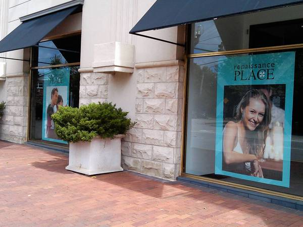 Advertisements for Renaissance Place hang in the windows of the empty building formerly occupied by Saks Fifth Avenue. The shopping center's officials are asking the city for tax relief that could be passed on to existing tenants.