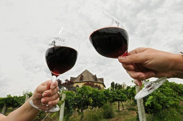 Narrow wine glasses lead to a lighter pour, scientists say.