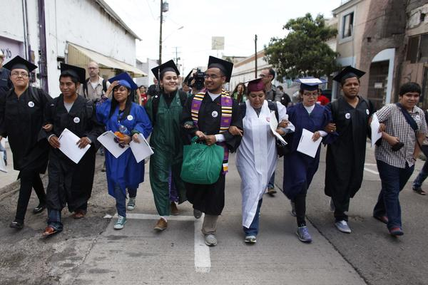 "In July, immigration rights activists, wearing their school graduation caps and gowns to show their desire to finish school in the U.S., marched with linked arms to the U.S. port of entry where they requested humanitarian parole in Nogales, Mexico. The activists, known as the ""Dream 9,"" were later arrested after attempting to cross the border. They were released from federal custody in August."