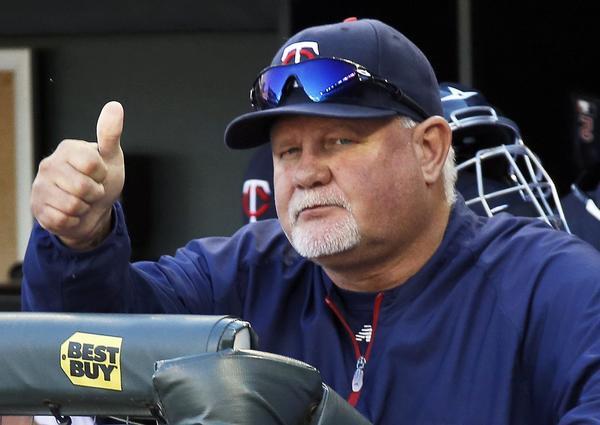 "Minnesota Twins manager Ron Gardenhire signals ""good luck"" to Cleveland Indians manager Terry Francona, as the Indians clinched an American League playoff spot with a 5-1 win over the Twins at Target Field in Minneapolis, Minnesota, Sunday."