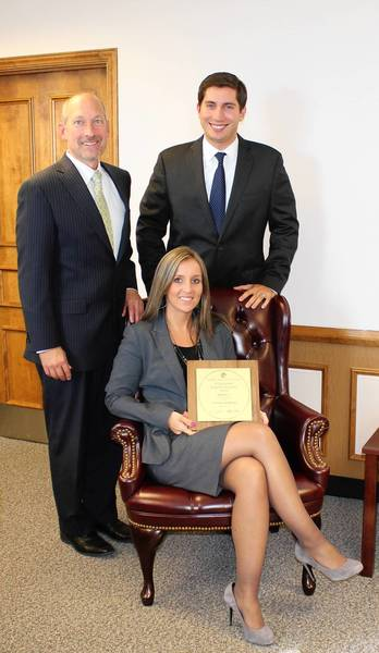 Left to right: Des Plaines City Manager Michael Bartholomew, Mayor Matthew Bogusz and Director of Finance Dorothy Wisniewski pose as Wisniewski displays an award recently given to the city by the Government Finance Officers Association.