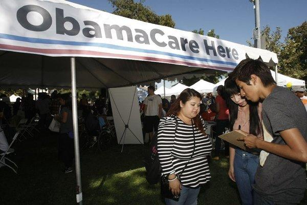 At the South L.A. Power Festival on Saturday, Gabriela Serrato, left, participates in a survey on better health with Dulce Rosas, 17, and Eric Bartolo, 17. Rosas and Bartolo are students at Fremont High School. Serrato, 29, came to the festival to find out more about Obamacare and to get involved in community organizations.