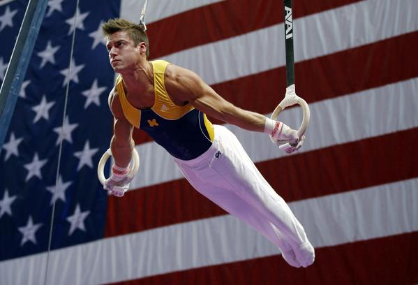 Sam Mikulak, shown at U.S. men's national gymnastics championships in August, leads in the standings after the first of four subdivisions at the World Gymnastics Championships in Antwerp, Belgium.