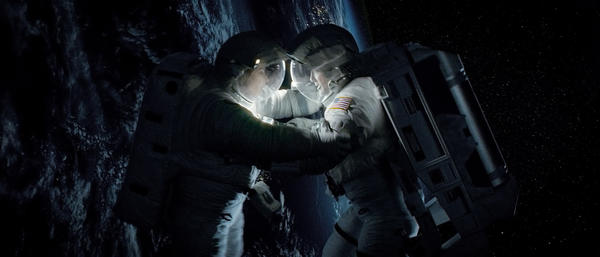 "Sandra Bullock as Ryan Stone and George Clooney as Matt Kowalski in Warner Bros. Pictures' thriller ""Gravity."""