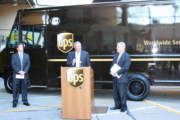 Ken Ender, president of Harper College, speaks at a UPS sorting facility in Chicago to announce a $1.4 million federal grant for a new Supply Chain Management Program. U.S. Senator Richard Durbin (right) and Breton Johnson of Northwestern University (left) also attended.