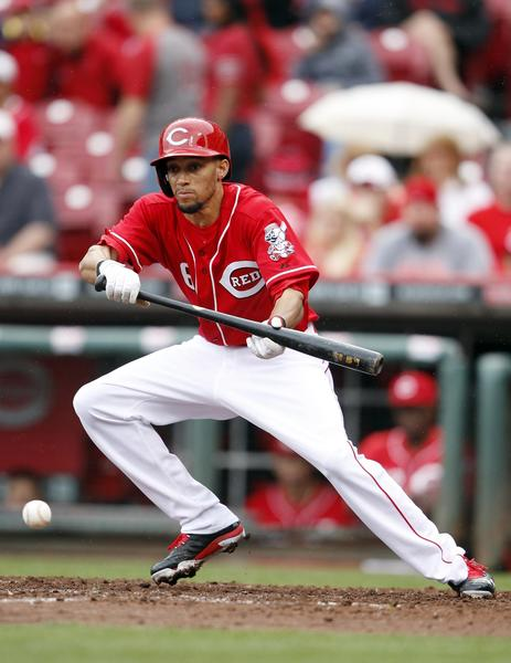 Sep 29, 2013/Cincinnati Reds center fielder Billy Hamilton sacrifice bunts during the eighth inning against the Pittsburgh Pirates at Great American Ball Park. The Pirates defeated the Reds 4-2.