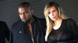 Kim Kardashian, Kanye West take in Paris Fashion Week sans North