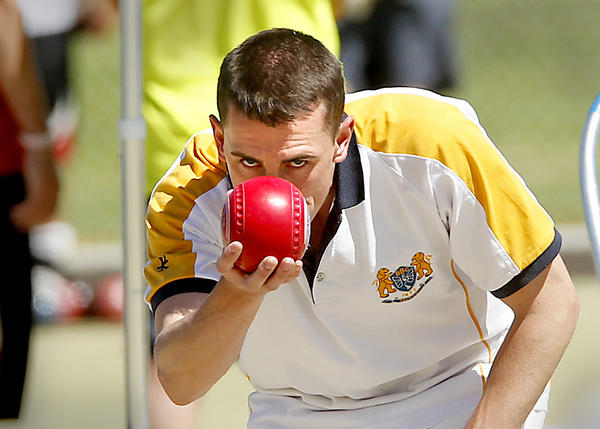 Aaron Sloen, from Northern Ireland, lines up a shot during the U.S. Open of Lawn Bowls at the Newport Harbor Lawn Bowling Club in Corona Del Mar.