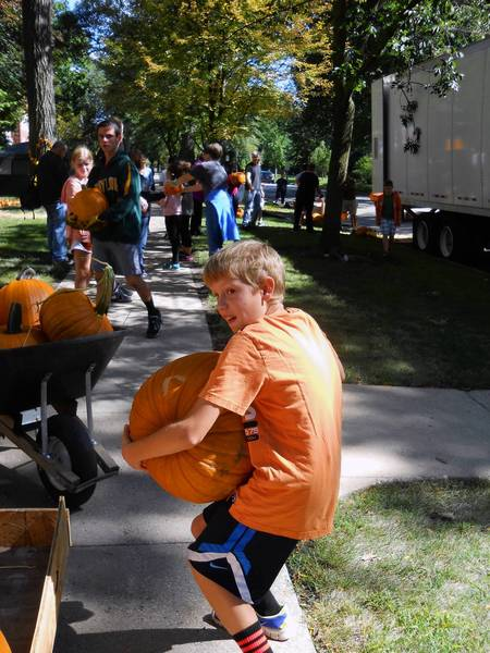 Liam Hill, 12, a member of Wilmette Boy Scouts Troop #3 and a sixth grader at Highcrest School, helps unload pumpkins Sunday for the 15th Annual Great Pumpkin Sale at Trinity United Methodist Church.