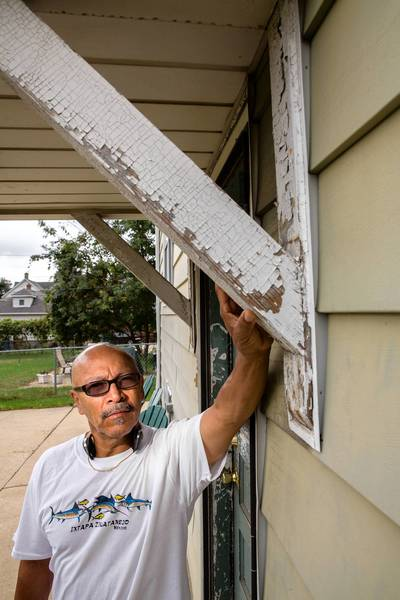 "After waiting for months, Nicolas Ornelas ""is feeling great"" now that work has begun to remove the lead paint from his Blue Island property. ""That's a big load off my shoulders."""