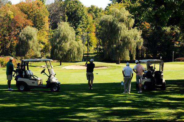 Golfers participate in a tournament to benefit Mark DeFilippo at Farmington Woods Golf Course in Avon Monday afternoon. He was paralyzed after a car accident in May.