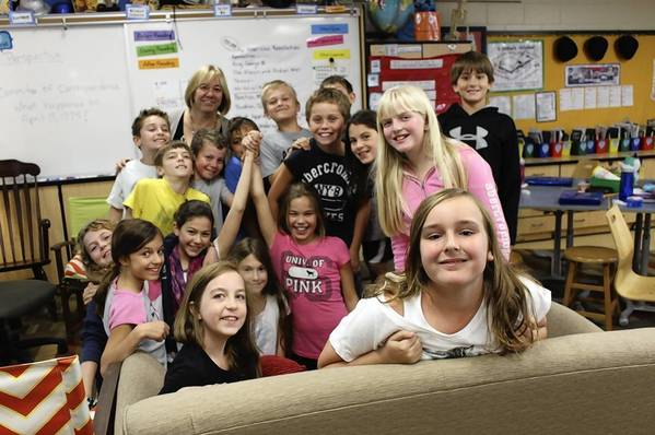 Fifth graders in Darlene Andre's class at Greenbriar Elementary School take a break from their lesson to smile for a photo on the day of the Blue Ribbon announcement on Sept. 24.