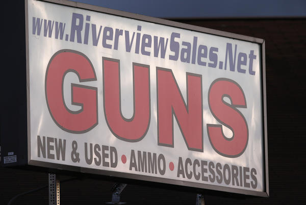 The sign atop the closed Riverview Gun Sales shop in East Windsor.