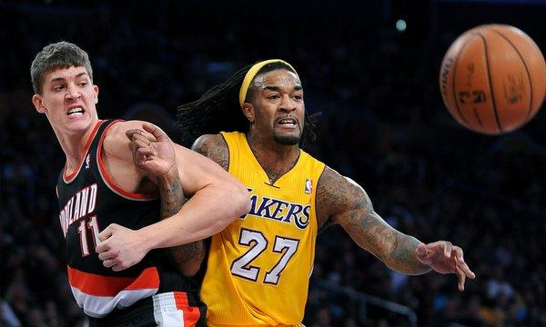Lakers forward Jordan Hill, right, battles for position with Portland's Mayers Leonard during a game last season. Is Hill capable of playing at power forward for the Lakers this season?