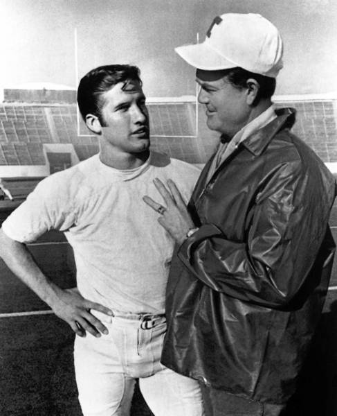 "In this 1969 file photo, Darrell Royal, right, head coach of No. 1 ranked Texas, talks with his quarterback, James Street, in Austin, Texas. Street led Texas to 20 consecutive victories, including the ""Game of the Century"" — a come-from-behind, 15-14 victory by the top-ranked Longhorns over No. 2 Arkansas to cap the 1969 regular season."