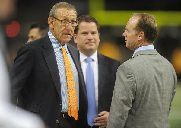 Miami Dolphins owener Stephen Ross and GM Jeff Ireland meet on the sidelines before the game against the Saints. Miami Dolphins vs. New Orleans Saints. Mercedes-Benz Superdome, New Orleans, LA. 9/30/13. Jim Rassol, Sun Sentinel.