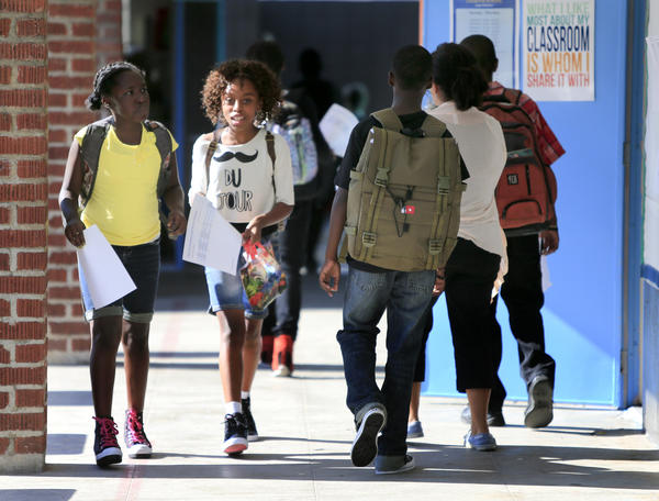 Students look for their classrooms on the opening day of instruction at the Westchester Secondary Charter school.