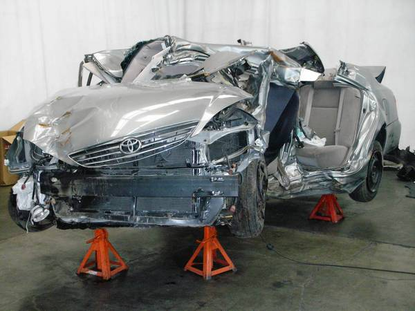 Noriki Uno's 2006 Toyota Camry is shown after the 2009 crash in which she died. Her family is suing Toyota, alleging that a defect caused the Camry to suddenly accelerate. Uno's car sped to 100 mph before hitting a telephone pole and a tree.