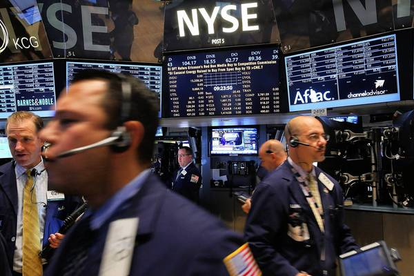 Traders work on the floor of the New York Stock Exchange. Stocks fell as a federal government shutdown loomed.