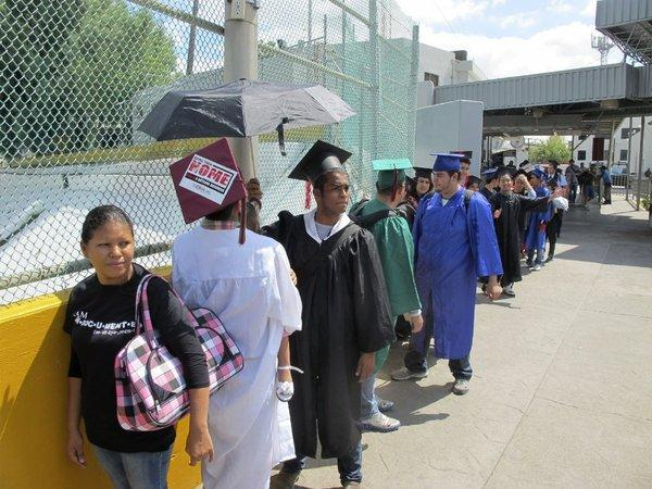 Immigration activists wearing graduation caps and gowns try to enter the U.S. in Laredo, Texas.