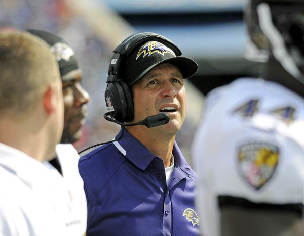 Ravens coach John Harbaugh keeps an eye on the field as his team plays the Buffalo Bills.