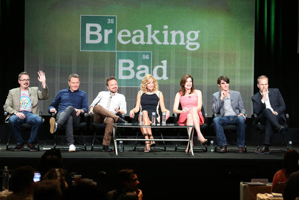 """(L-R) Producer/director Vince Gilligan and actors Bryan Cranston, Aaron Paul, Anna Gunn, Betsy Brandt, R.J. Mitte, and Bob Odenkirk speak onstage during the """"Breaking Bad"""" panel discussion at the AMC portion of the 2013 Summer Television Critics Association tour - Day 3 at the Beverly Hilton Hotel on July 26, 2013 in Beverly Hills, California."""