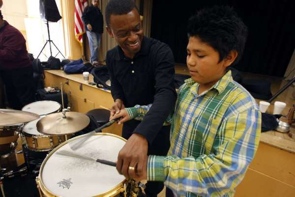 Jazz drummer Clayton Cameron gives a lesson to LAUSD student Tomas Ramos in this 2011 photo. A bill signed into law Monday will allow California taxpayers to donate to arts education via a checkoff on state income tax forms.