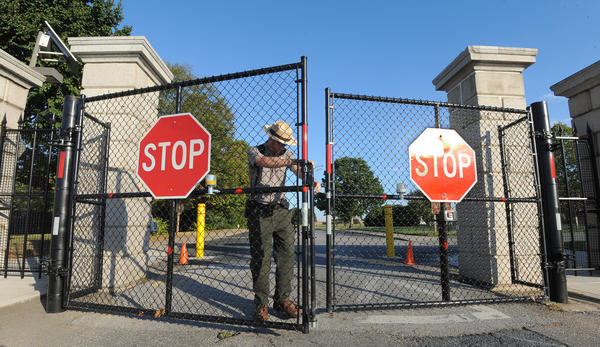 Park Ranger Shaun Lehmann locks up Fort McHenry at the end of the day on the eve of a potential government shutdown.