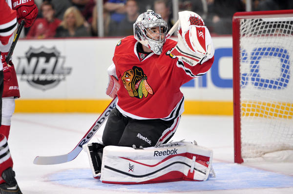 Corey Crawford and the Blackhawks begin defense of the Stanley Cup on Tuesday against the Capitals.