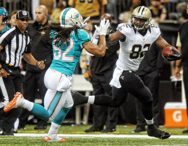 Philip Wheeler tries to bring down Benjamin Watson of the Saints in the second quarter. Miami Dolphins vs. New Orleans Saints. Mercedes-Benz Superdome, New Orleans, LA.