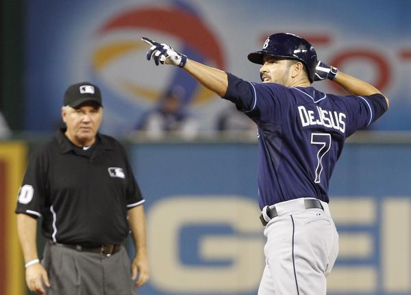 Rays left fielder David DeJesus celebrates his run-scoring double in the sixth inning.