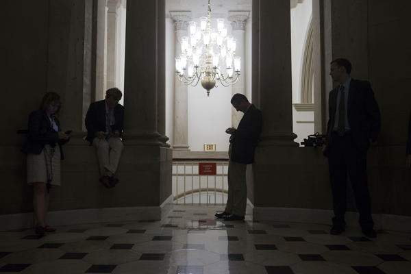 Members of the media stand outside House Speaker John A. Boehner's office at the U.S. Capitol.