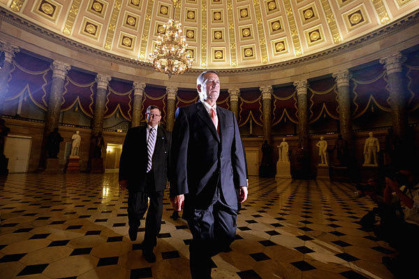 House Speaker John A. Boehner (R-Ohio) heads for the House floor. At midnight, the Republican-led House and the Democratic-led Senate remained at an impasse.