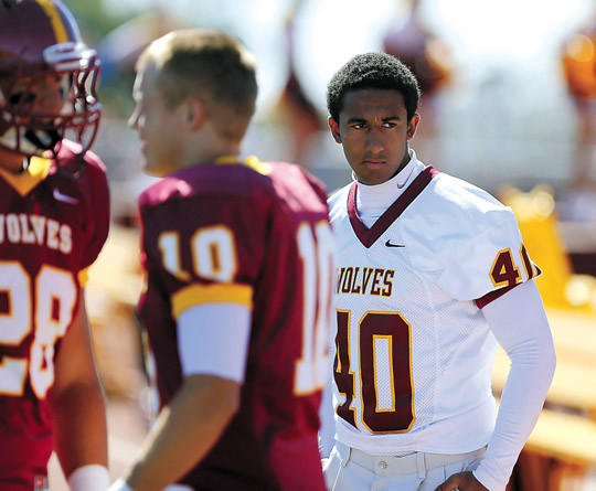 Northern State University reserve player Aaron Mayo, right, watches from the sideline during Saturday's game against Upper Iowa at Swisher Field. photo by john davis taken 9/21/2013
