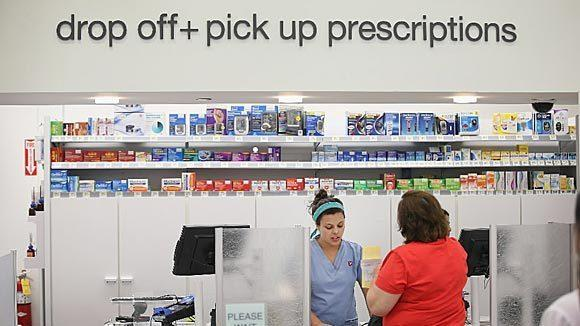 Pharmacy technician Angelina Lombardo helps a customer at a Walgreens pharmacy in September in Wheeling.