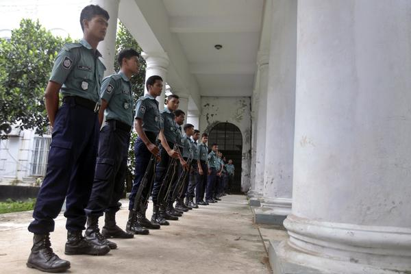 Bangladeshi police officers stand guard outside a special war crimes tribunal in Dhaka.