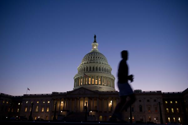 A man jogs past the U.S. Capitol in Washington D.C. Monday. The U.S. government began a partial shutdown on Tuesday for the first time in 17 years.