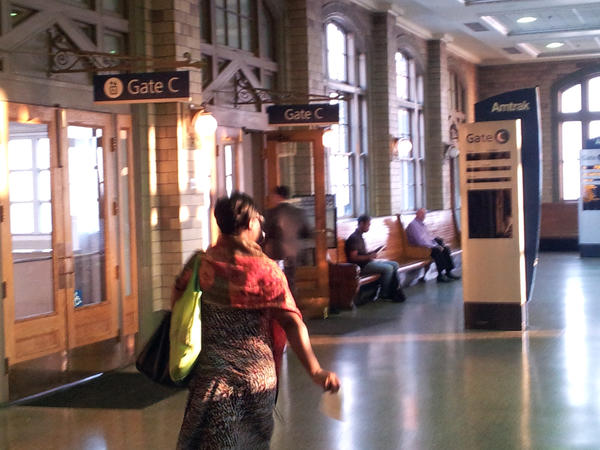 A morning commuter rushes to catch a train from Baltimore to Washington at Penn Station on Tuesday morning.