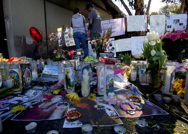 A roadside memorial is growing in Burbank where five young adults died.