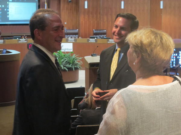 Former U.S. Congressman Ron Klein chats with fellow lobbyists Neil Schiller and Judy Stern.