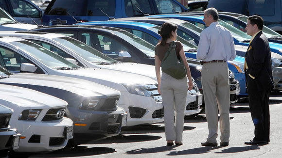 Customers shop for Fords at a Glendale, Calif., dealership.