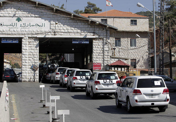 A convoy of inspectors from the Organization for the Prohibition of Chemical Weapons prepares cross into Syria on Tuesday at the Lebanese border crossing at Masnaa, Lebanon.